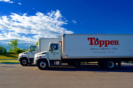 Topper Linen and Uniform Company Delivery Trucks